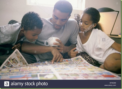 african-american-father-and-children-reading-newspapers-comics-DFAE2M