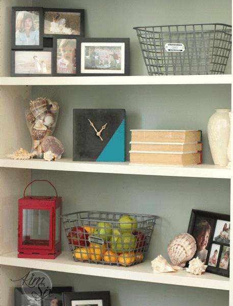 Concrete clock on shelf