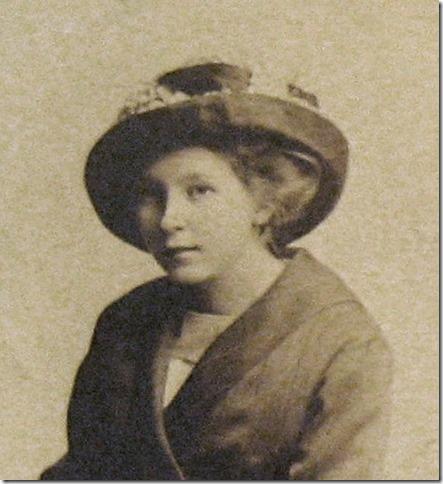 MILNE_Irene_headshot wearing a hat_enh