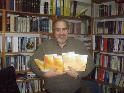 Dr Argyris Petrou holding commentaries