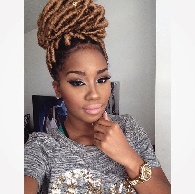 girl with gold faux locs