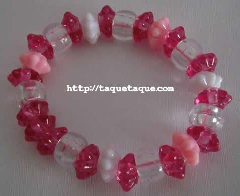pulsera multicolor: dos tonos rosas, blanco y transparente