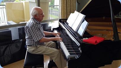 Rob Powell playing the Village's Kawai grand piano.