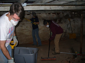 Roy, Ginger, and Cindy cleaning the basement of the Maryland woman's house.