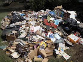 Ruined tomes on the lawn of the Wells Memorial Library in Upper Jay, New York