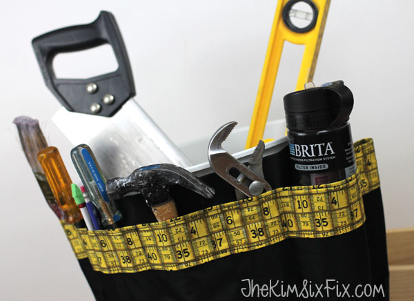 Canvas tool organizer ties on bucket