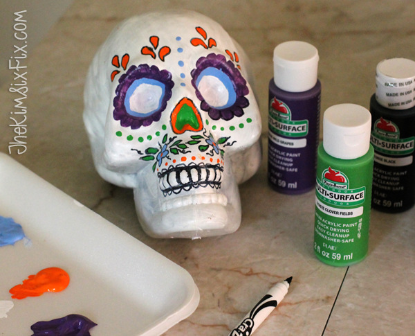 Tracing paint on day of the dead skull