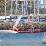 The ILB crew search for the capsized dinghy's crew member off the Parkstone Yacht Club breakwater - 3 May 2015.  Photo credit: Dave Riley