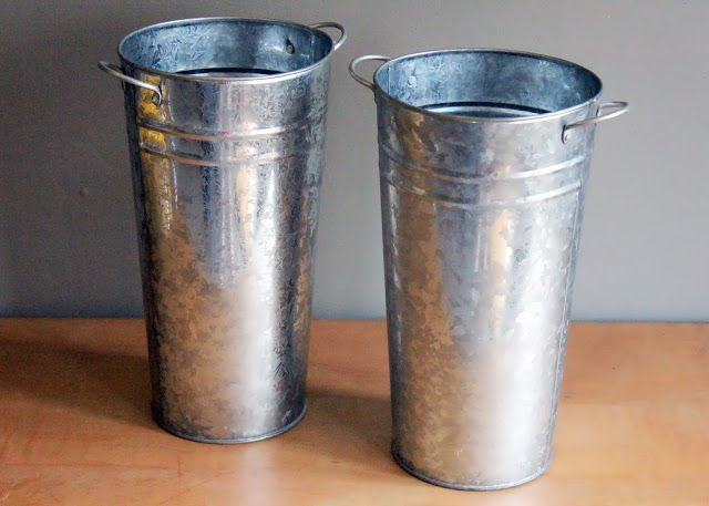 Tall metal pails available for rent from www.momentarilyyours.com, $2 each.