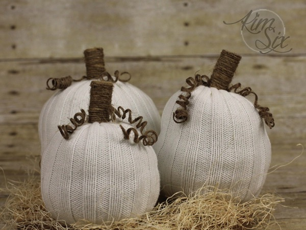 Sweater pumpkins with twine vine