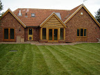 Windows and doors in stained softwood
