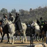 Men on horseback lead the procession of Bojale initiates