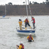 Crew members walk a tow rope from the ILB to the yacht's bow - 21 April 2013.  Photo credit: Dave Riley