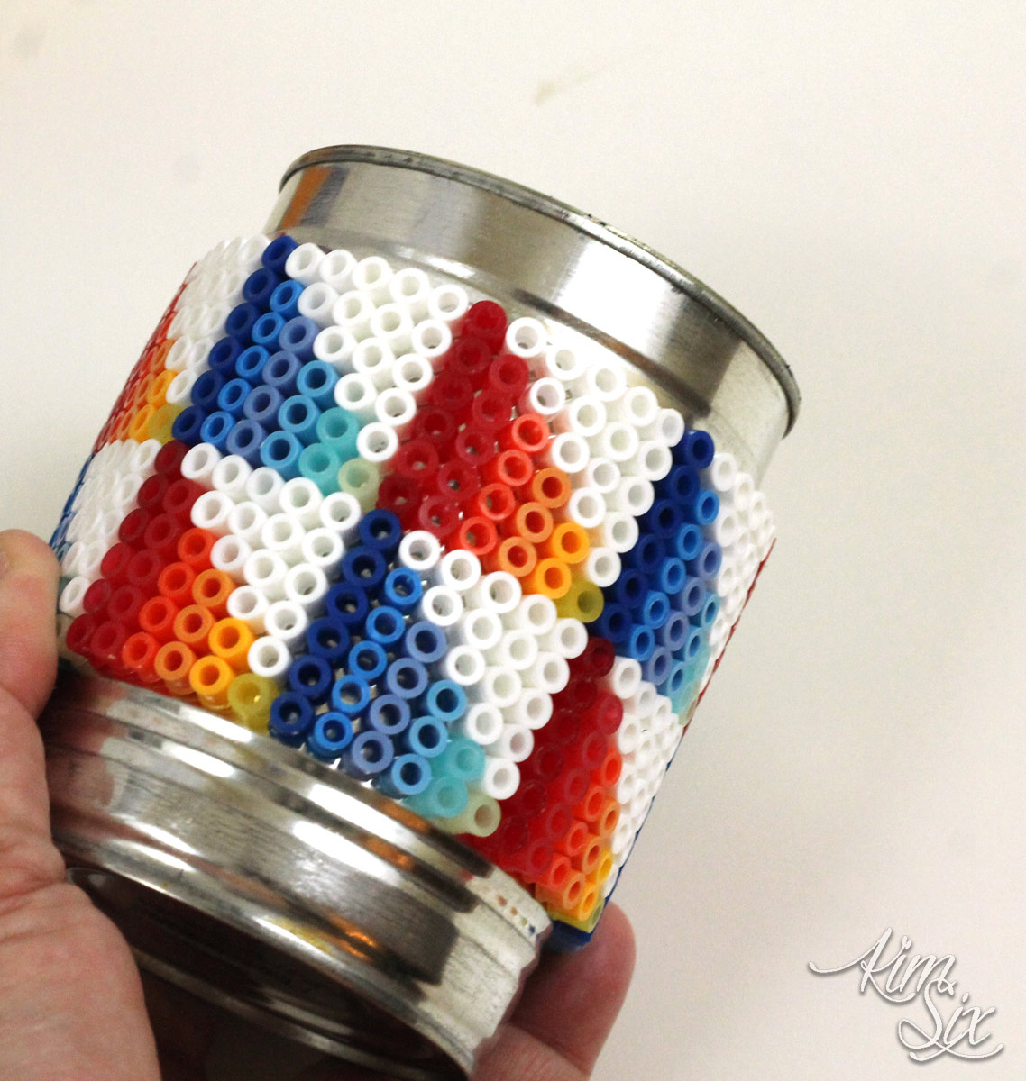 Wrapping pearler beads around tin can