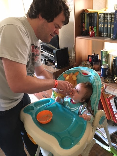 Keith Feeding Cecilia in high chair