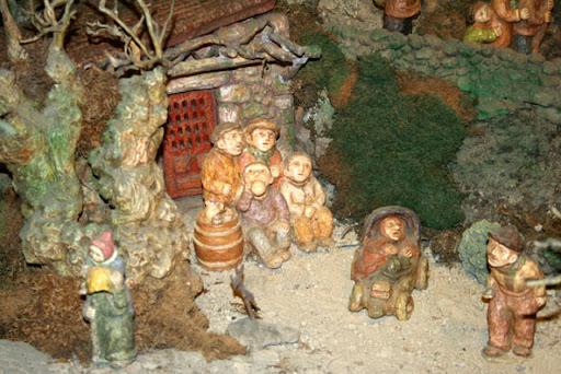 Belen de Baltar: imagen de un grupo de hombres junto a un tullido muy famoso a comienzos del siglo XX en la ciudad de Ourense