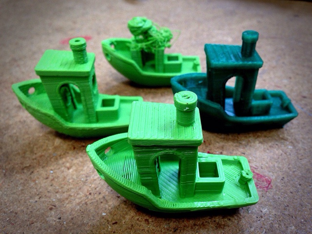 A small flotilla of 3D printed boats (test pieces for printer calibration).