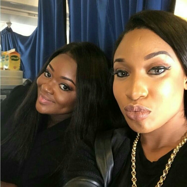 Image result for jackie appiah pictured with tonto dikeh on a flight