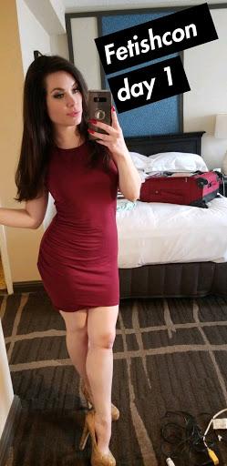 In her hotel room, Jasmin Jai wears a maroon cotton short dress and heels for a mirror selfie