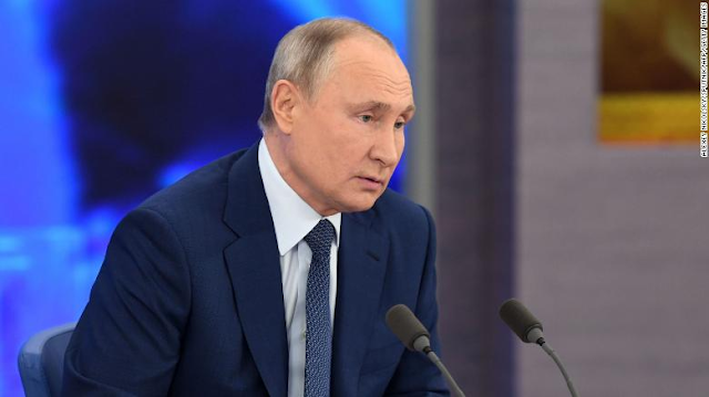 Putin signs law extending nuclear arms treaty between US and Russia