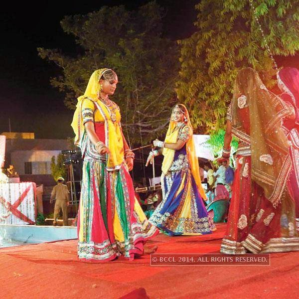 Artists perform during Teej procession in Jaipur.