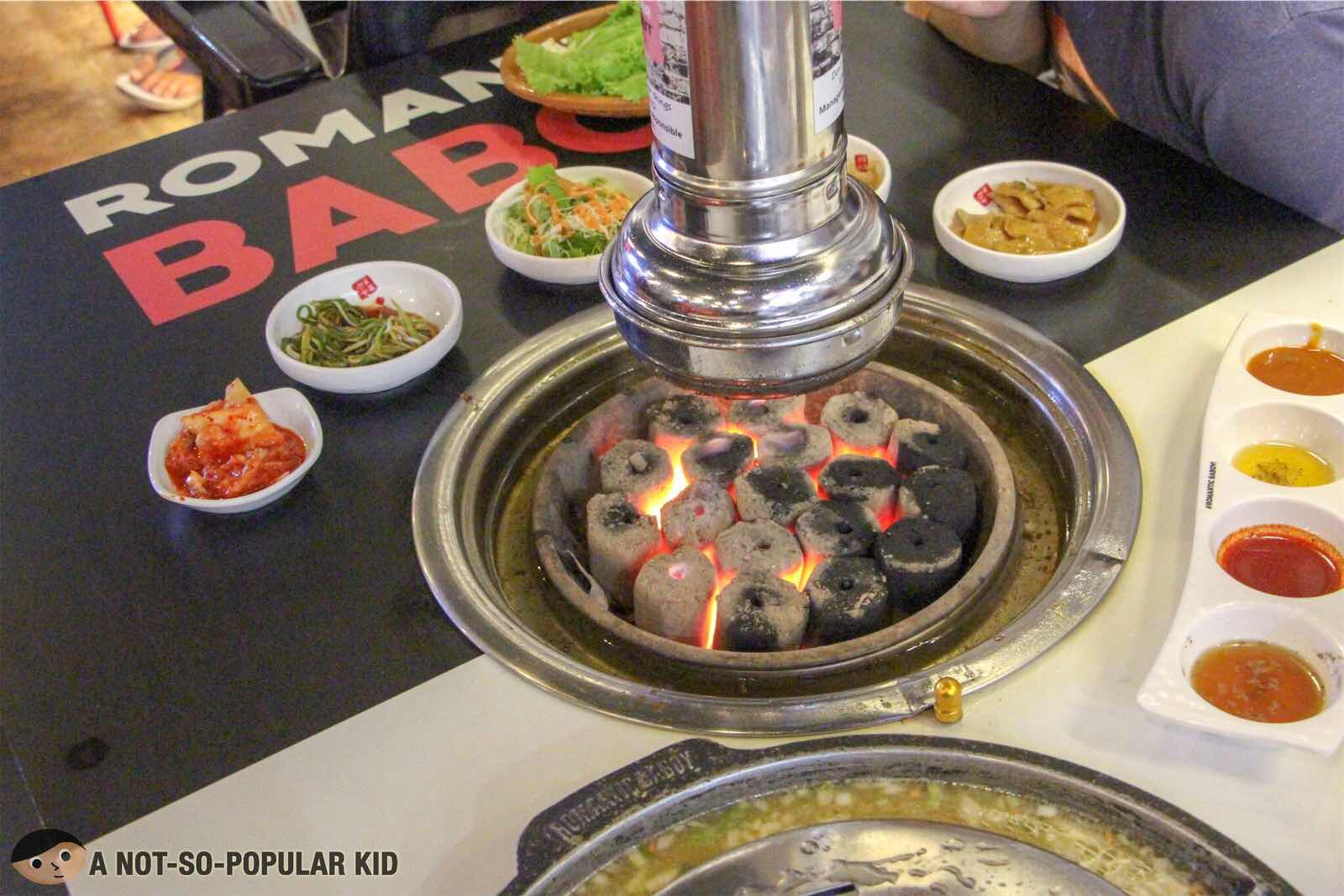 Charcoal grill of Romantic Baboy - Unlimited Samgyupsal