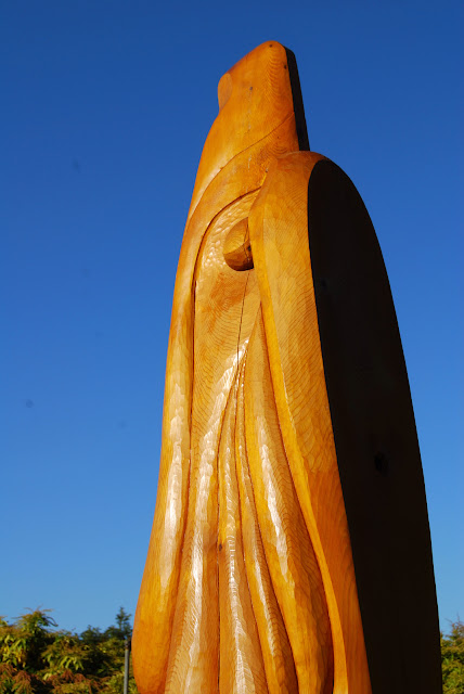 An eagle head carved from wood rises from the groundCredit: Bellingham Whatcom County Tourism