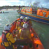 The lifeboats return the kayakers and their kayaks to Knoll Beach - 12 April 2015