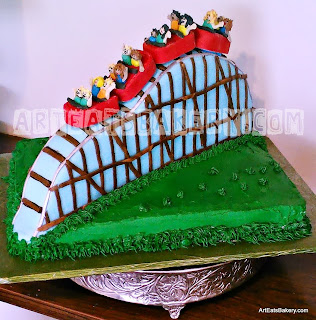 3D roller coster father's day cake with edible cars full of families