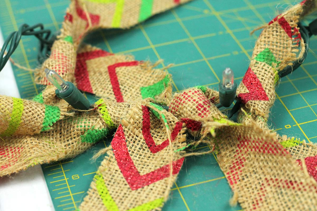 Tying Burlap to Mini Lights