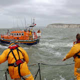 Swanage lifeboat crew making their heaving line and tow rope ready during a training exercise with Poole all-weather lifeboat in Poole Bay on Sunday 23 February 2014. Photo: RNLI/Dave Riley