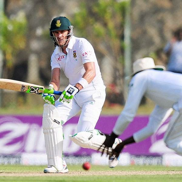 South Africa cricketer Faf du Plessis (L) plays a shot as Sri Lankan cricket captain Angelo Mathews attempts to catch the ball during the first day of the opening Test match between Sri Lanka and South Africa at the Galle International Cricket Stadium in Galle on July 16, 2014.