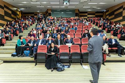 Man giving a speech to attendees