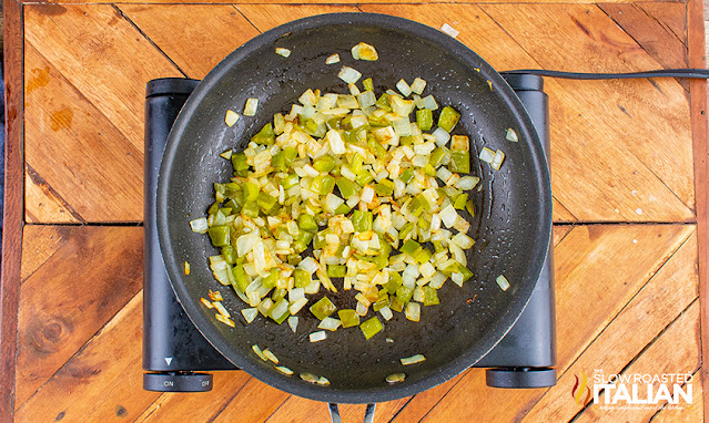 peppers and onions in skillet