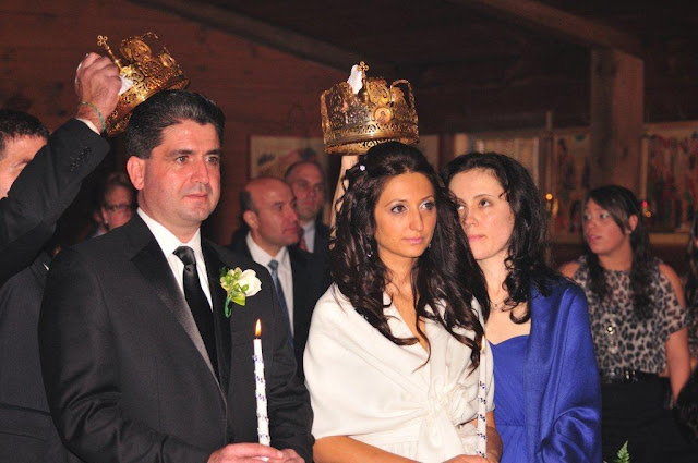 The sponsors (best man, maid of honor) hold the crowns over the heads of the bride and bridegroom.  The crowns represent the heavenly crowns of martyrdom, recognizing that marriage is in its own way a mystical form of martyrdom and path to salvation.