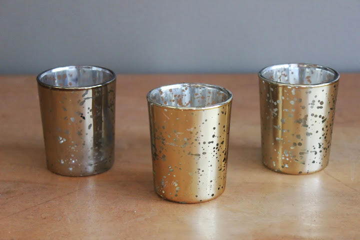 Champagne-colored mercury glass pillar holders from the rental inventory of www.momentarilyyours.com, $1.