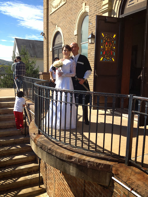 Keti & Lasha outside the church before the Wedding.
