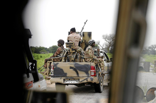 Caught in the crossfire: A Nigerian army convoy vehicle drives ahead with an anti-aircraft gun, on its way to Bama, Borno State, Nigeria in 2016. The area is now controlled by Islamic State West Africa, which split from Boko Haram and is now the bigger threat in the country's northeast. Picture: REUTERS