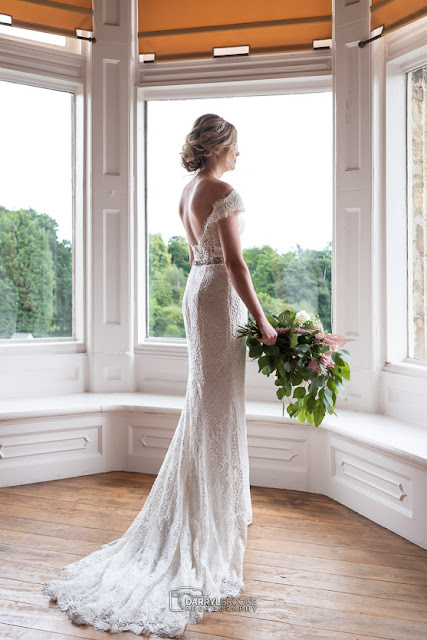 Bride at the window of Cave Castle Hotel