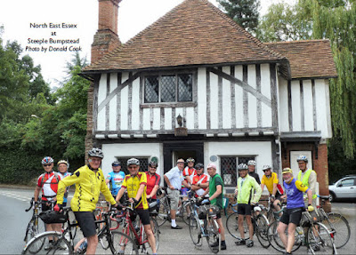 Group outside half timbered house