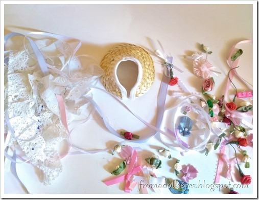 The bonnet is ready to be decorated, surrounded by all sorts of bows, ribbons, flowers and lace.