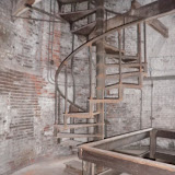 The last 70 feet of the ascent is by a spiral metal stair.