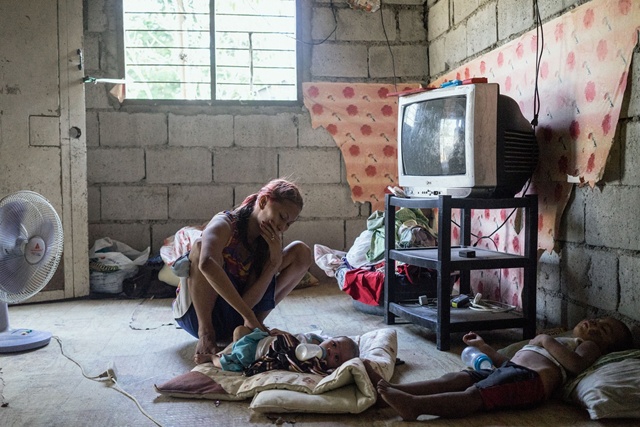Jojo was forced into the Philippines' sex trade after she was displaced by Typhoon Haiyan. In this photo, Jojo tends to her children in her home in Angeles City, Philippines. Photo: Hannah Reyes Morales
