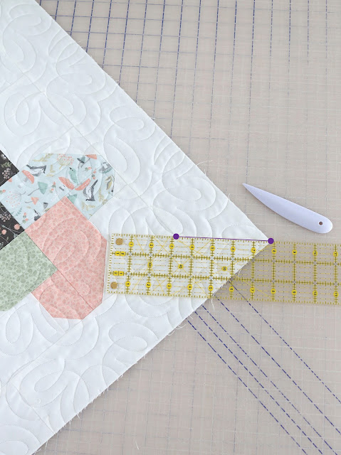 How to add a scallop border to a quilt - a great tutorial by A Bright Corner - she makes it look easy!