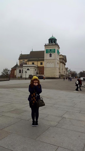 Standing in the market square of the old town of Warsaw Poland