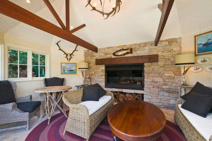 Cosy Federation games room at Kooyong Estate, 55 Hastings Road Warrawee showing wicker furniture and Arts and Crafts finishes
