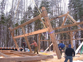 The thrid bent is lifted into position.  The trussed bent can be seen in the background.