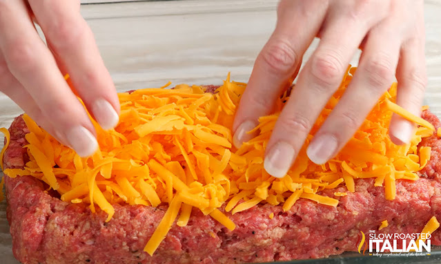 Adding cheese to the bottom half of the meatloaf
