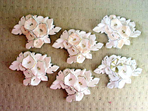 "9""W plaster rosettes, $7 each or $35 all"