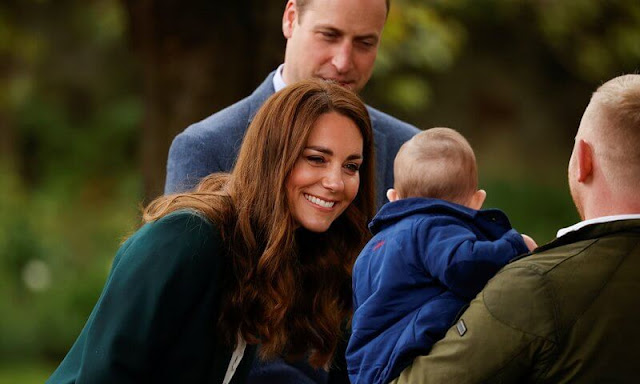 Kate Middleton wore a green wool wool blazer by Massimo Dutti, and a new silk spot print cardigan by Jigsaw, and cricket sweater by Ralph Lauren
